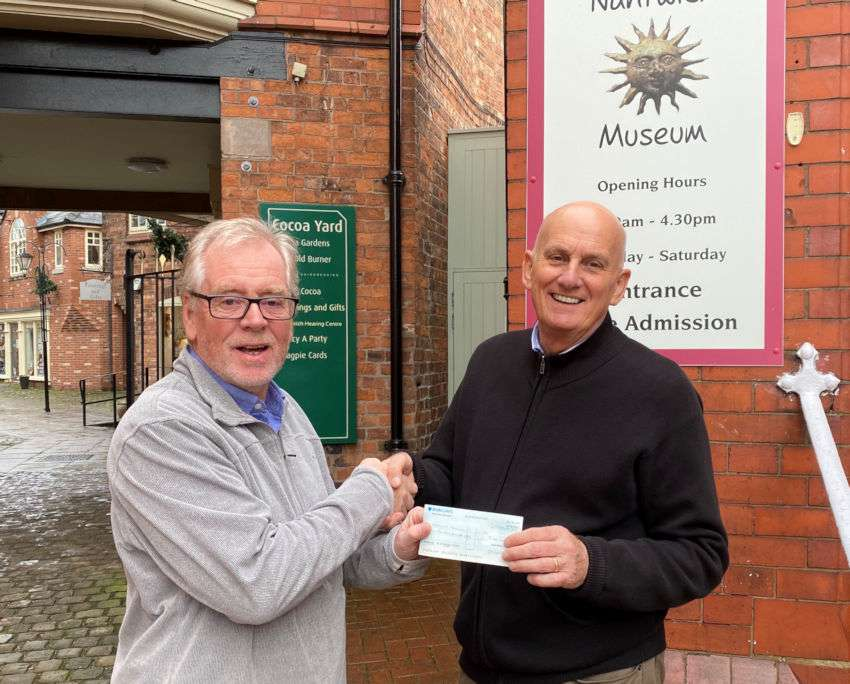 Nick Dyer (left) receives the cheque from Jeff Stubbs Chair of Nantwich Civic Society.